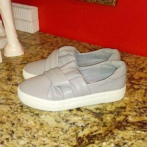1021 J/Slides Across Sneakers
